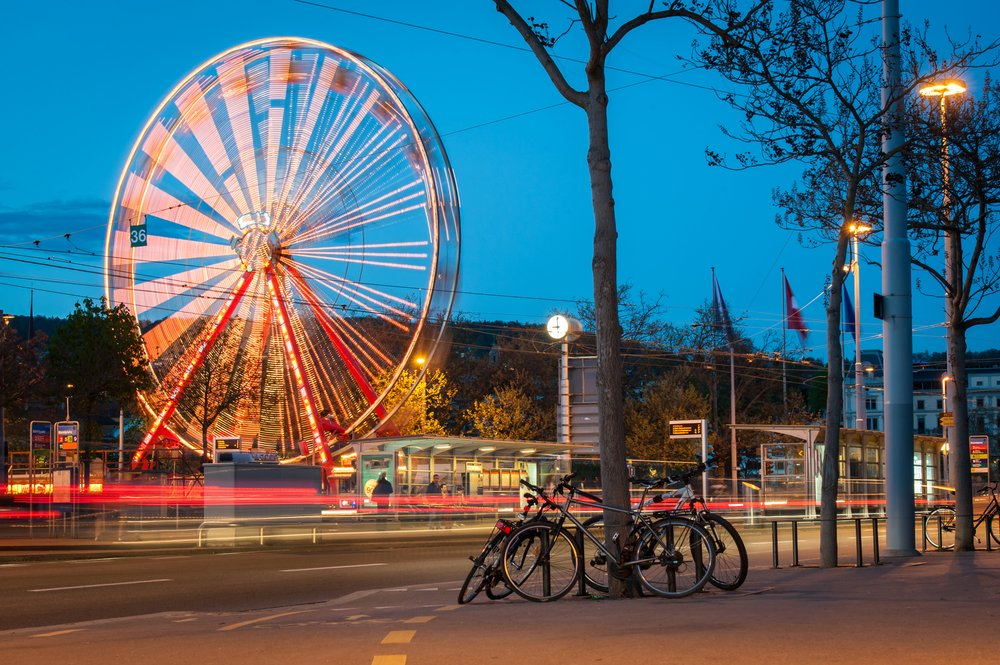 Ferris wheel and street traffic in Zurich