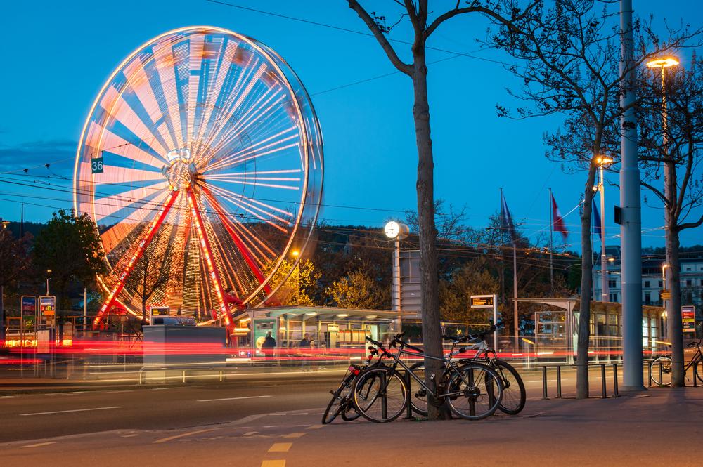 Ferris wheel and street traffic in Zurich